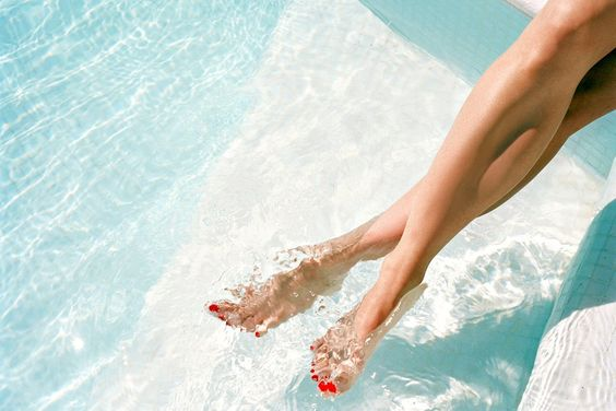 Legs and feet in pool